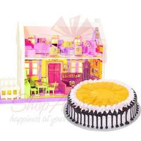 mango-cake-with-doll-house
