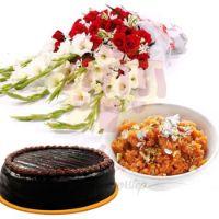 gajjar-halwa,-cake-and-flowers